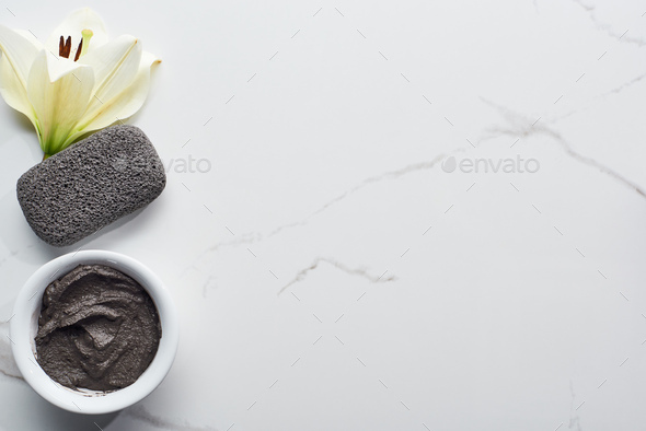 Top View of Natural Clay Mask And Pumice Stone Near Fresh Flower on Marble Surface - Stock Photo - Images