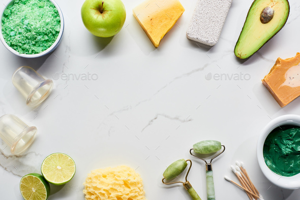 Massage Jars, Facial Rollers, Bath Sponge, Pumice Stone And Fresh Fruits And Vegetable on Surface - Stock Photo - Images