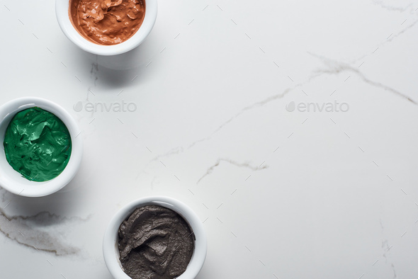 Top View of Cups With Diverse Natural Beauty Products on Marble Surface - Stock Photo - Images