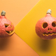 Top View of Carved Halloween Pumpkins on Orange Background - PhotoDune Item for Sale