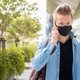 Portrait of man with mask talking on the phone in the city outdoors - PhotoDune Item for Sale