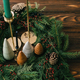 Christmas trees and candles in rustic christmas wreath on dark wood - PhotoDune Item for Sale