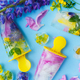 Floral Ice Pops. Colorful wildflowers in frozen popsicles and ice cubes on blue background - PhotoDune Item for Sale