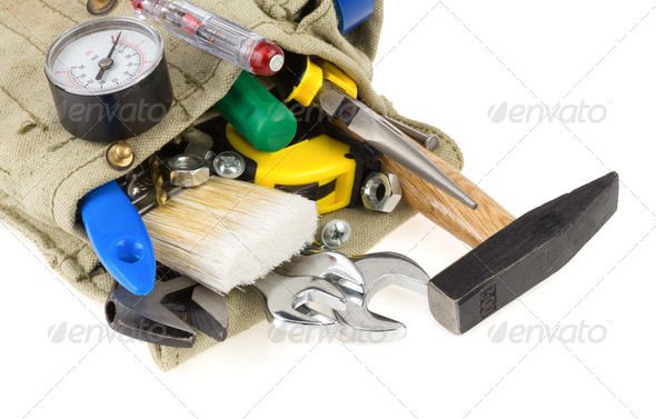 tools in belt bag isolated on white - Stock Photo - Images