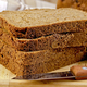 Rye homemade bread stacked with a knife on a board - PhotoDune Item for Sale