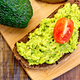 Sandwich with guacamole avocado and tomato on board - PhotoDune Item for Sale