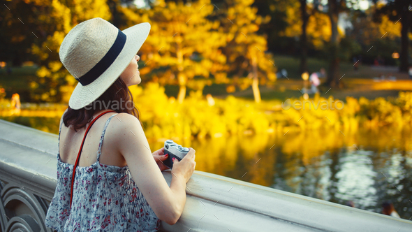 Beautiful girl with a retro camera in Central Park - Stock Photo - Images
