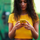 Young Arab woman walking in the street using her smartphone - PhotoDune Item for Sale