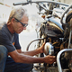 Senior Man Fixing Vintage Motorcycle Engine - PhotoDune Item for Sale