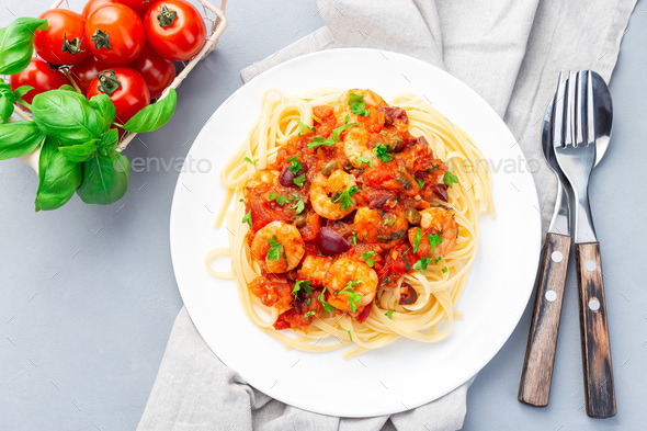 Puttanesca pasta with shrimps, horizontal top view - Stock Photo - Images