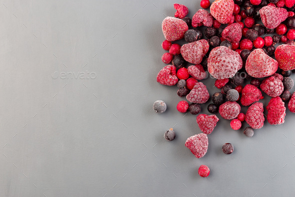 Frozen berries on gray background, copy space, top view - Stock Photo - Images