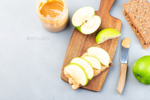 Sandwich with cracker, green apple and peanut butter, copy space - Stock Photo - Images