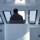 Man navigating a boat - PhotoDune Item for Sale