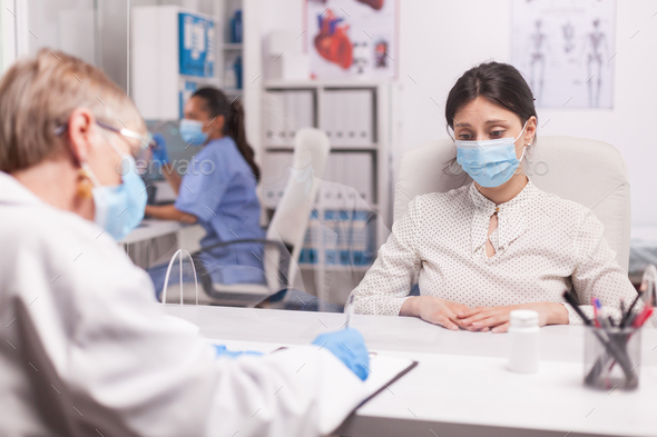 Stressed young patient wearing mask - Stock Photo - Images