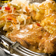 Braised pork in own sauce served with boiled potatoes and salad. - PhotoDune Item for Sale