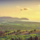 Maremma sunset panorama. Countryside, sea and Elba on horizon. San Vincenzo, Tuscany, Italy. - PhotoDune Item for Sale