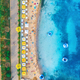 Aerial view of sandy beach with umbrellas, blue sea in summer - PhotoDune Item for Sale
