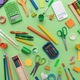 School supplies on green color background, top view - PhotoDune Item for Sale