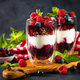 Parfait with granola, jam and fresh berries in the glass jar - PhotoDune Item for Sale