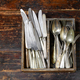 Collection of old vintage cutlery in a wooden tray - PhotoDune Item for Sale