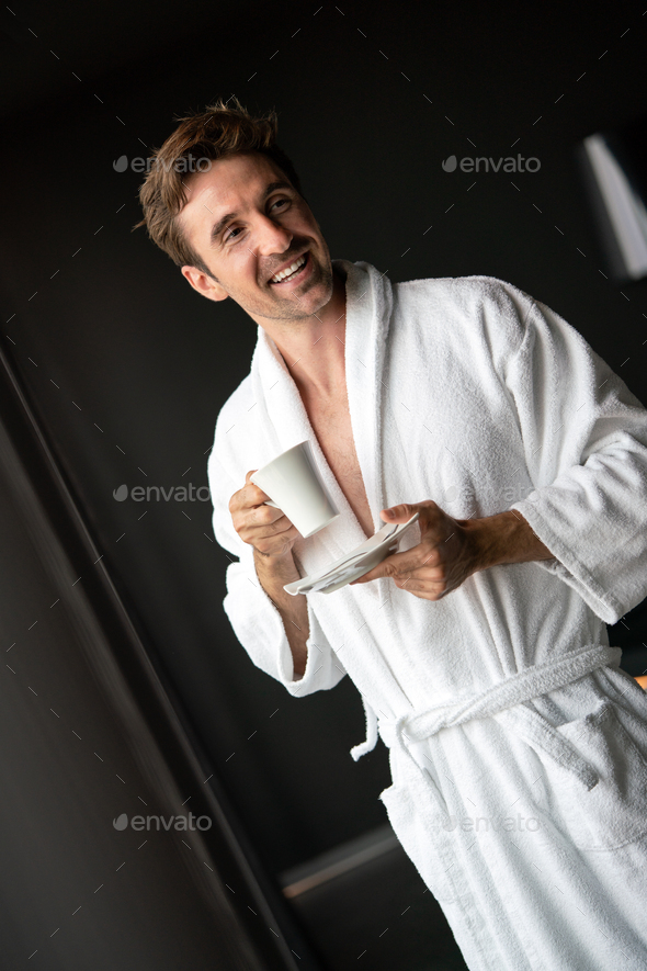Handsome man in bathrobe relaxing at spa wellness hotel