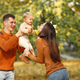 Family with little daughter in a autumn park - PhotoDune Item for Sale