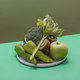 Fresh green vegetables and fruits on green table - PhotoDune Item for Sale