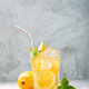 Lemon ice tea on concrete gray background with mint and ice - PhotoDune Item for Sale