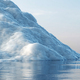 Melting iceberg on the ocean. Global warming and climate change - PhotoDune Item for Sale