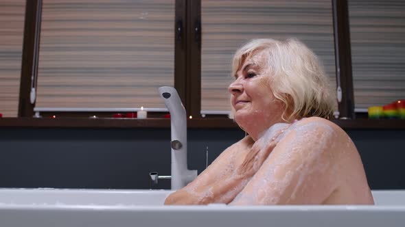 Blonde sexy granny Sexy Senior Elderly Blonde Woman Grandmother Is Taking Foamy Bath In Luxury Bathroom With Candles By Skeldry