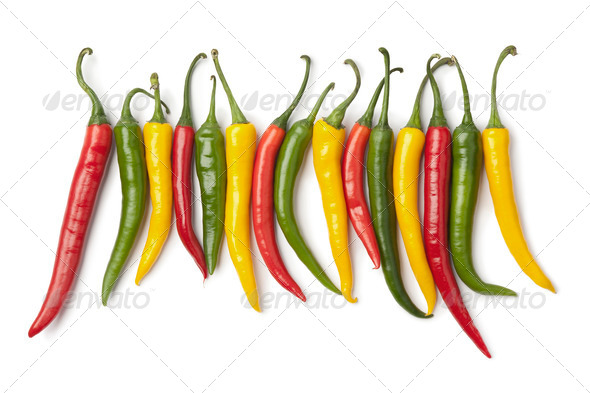 Red, yellow and green chili peppers in a row - Stock Photo - Images