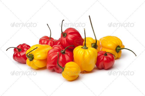 Yellow and red Scotch bonnet chili peppers - Stock Photo - Images