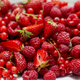 Fresh summer red fruit background composition. Strawberries, red currants, raspberries - PhotoDune Item for Sale