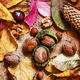 Autumn background with nuts and red and yellow leaves - PhotoDune Item for Sale