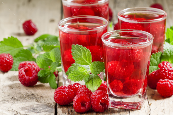 Red refreshing cocktail with raspberry and mint - Stock Photo - Images
