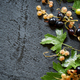 White and black currants with leaves on wet black stone background, top view - PhotoDune Item for Sale