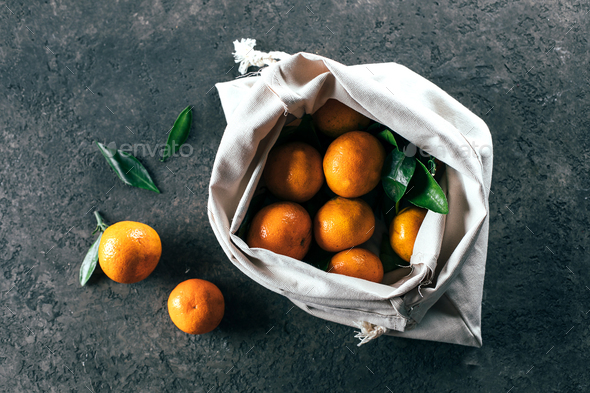 Ripe mandarine tangerine in cotton bag. Zero waste concept - Stock Photo - Images