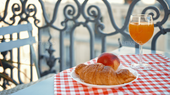 Breakfast on a balcony in Paris - Stock Photo - Images