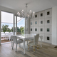 Modern Dining Table in a Living Room with Old Chandelier overlooking on the Terrace - PhotoDune Item for Sale