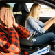 Woman and scared instructor in car, driving school - PhotoDune Item for Sale