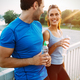 Athletic couple jogging together - PhotoDune Item for Sale