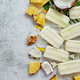 Homemade pineapple coconut popsicles on stone background. Summer food concept with copy space - PhotoDune Item for Sale