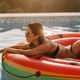 woman with sexy butt relax in swimming pool on inflatable fun beach floaty outdoors - PhotoDune Item for Sale