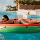 sexy woman relax in swimming pool on inflatable fun beach floaty outdoors - PhotoDune Item for Sale