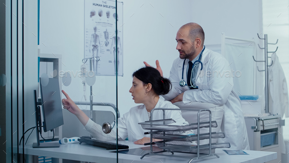 Consulting over a medical problem - Stock Photo - Images