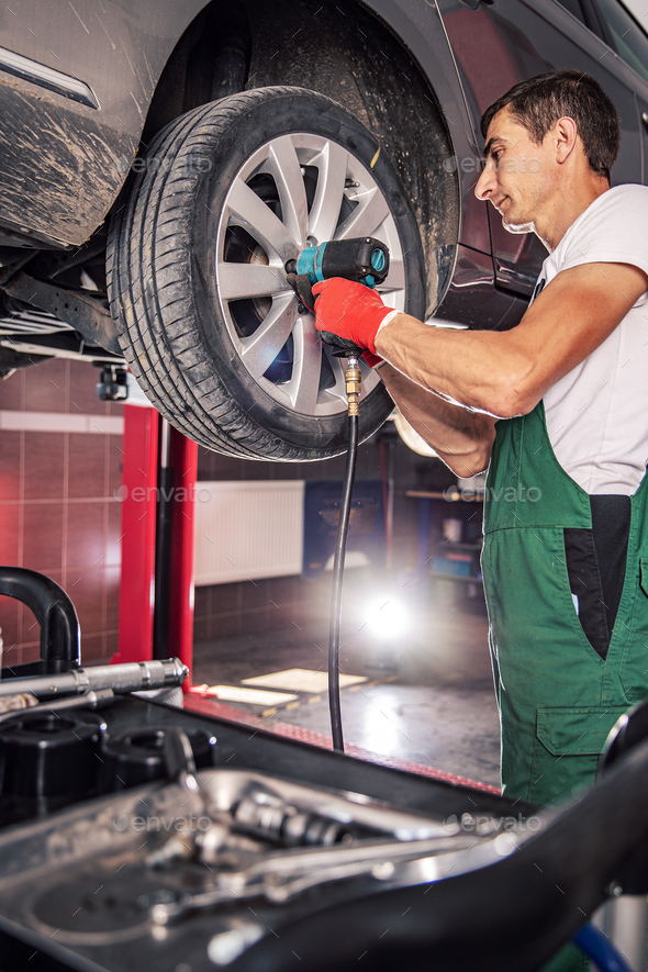 Mechanic in uniform is working - Stock Photo - Images
