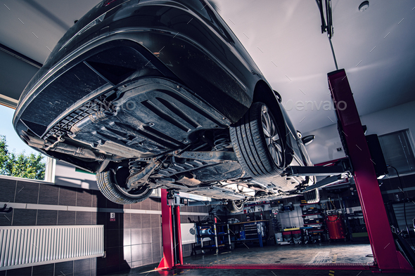 Lifted car in garage - Stock Photo - Images