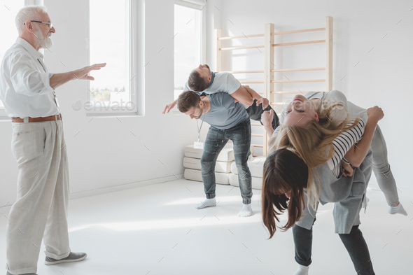 Spine mobilization with partner - Stock Photo - Images