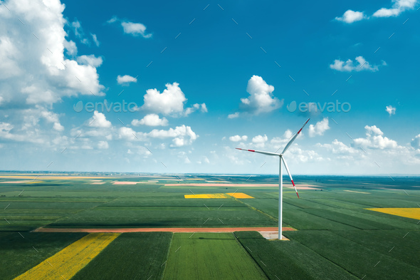 Aerial view of wind turbines on modern wind farm from drone pov - Stock Photo - Images