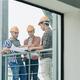 Builders checking building blueprint - PhotoDune Item for Sale